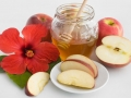 red flower,honey with apple for  jewish new year
