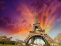 Wonderful view of Eiffel Tower in Paris. La Tour Eiffel with sunset sky and meadows